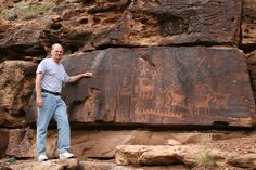 Expert in Chinese Petroglyphs Supports Theory Ancient Chinese Made It to America. John A. Ruskamp stands near petroglyphs that match ancient Chinese script in Nine Mile Canyon, Utah. (Courtesy of John A. Ruskamp)