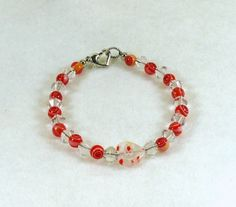 Swarovski Bicones and Peach Millefiore Beaded Bracelet #727 $15.00 http://www.artfire.com/ext/shop/studio/HCLTreasures