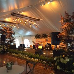 Orangerie Events commissioned this vintage, yet modern, band backdrop wall and paired it with vertically hung market lights and our Tray Edison Bulb Chandeliers.