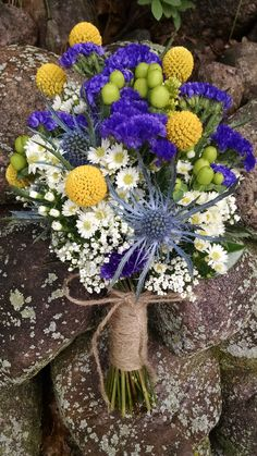 Loved it! Pinned it! A Blooming Envy Design! Bouquet with Purple Statice, Yellow Billy Balls, Green Hypericum Berries, White Feverfew, Baby's Breath and Blue Thistle, Twine Wrap