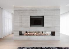 Contekst combines oak and concrete for minimal Belgian house