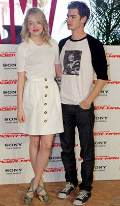 Emma Stone.  Guy looks like a dork, while his female companion is well-dressed and beautiful.  Typical.