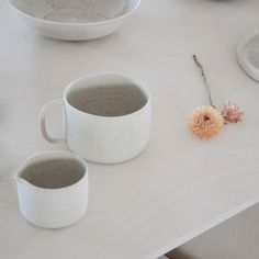 Ghost Wares handmade in Melbourne ceramic white speckle mug and milk jug on white stained birch plywood table.