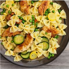 Bow Pasta With Chicken & Zucchini. Used broccoli florets instead of peas, be sure to thaw first, diced chicken works better, and sliced zucchini was delicious!