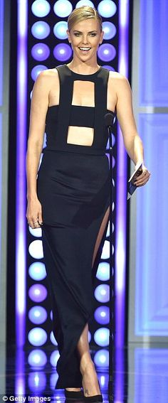 A cut above: Charlize Theron looked incredible in her daring dress as she took to the stag...