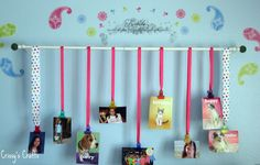 Neat idea for displaying pictures using a curtain rod, ribbon, & clips. Crissy's Craft: Wall Picture Display
