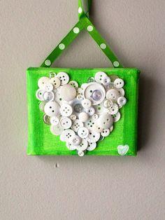 Handmade green and white button mosaic heart
