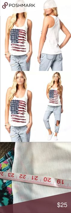 American Flag Racerback Tee! NEW!  A must have for summer! Unfinished hem. Measures 18.5 inches pit to pit. Length is 23 inches. Flag is dark but has more color than last pic appears to have. Location: tee bin Boutique Tops Tank Tops