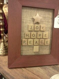In stead of using scrabble pieces why not just get some small sq pieces from your craft store and use a sheet of alphabet stencils. Scrabble Letter Crafts, Scrabble Tile Crafts, Scrabble Letters, Scrabble Ornaments, Christmas Makes, Christmas Signs, Christmas Art, Christmas Projects, Christmas Box Frames