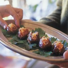 Dates Stuffed with Goat Cheese -- Wrap it in Prosciutto with a balsamic reduction drizzle!