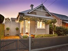 Love the cottage look that the garden vines creeping along the trim give this narrow house.