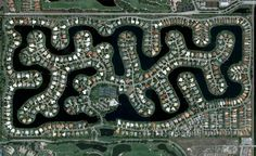 aerial patterns of human housing developments on google maps (6) Man made lake.  Now that's using every inch of lakefront property!