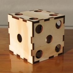 Rather unique... when not an art piece, this d6 breaks down into six coasters for your living room...