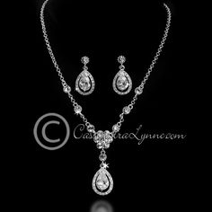 Teardrop rhinestones accent this flower wedding jewelry set. The necklace is 14 inches with a 2 inch extender, the earrings are 1.25 inches with post backs.