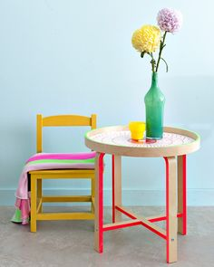 Painting colour blocks onto IKEA furniture to personalise it.