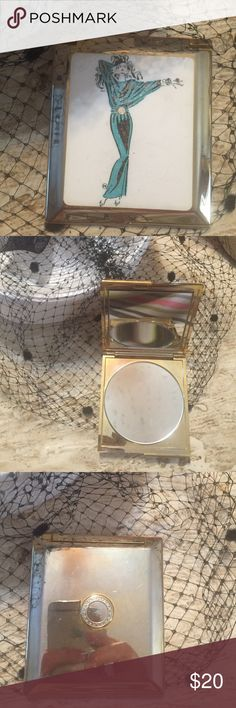 "Vintage Movie Star Mirrored Compact Vintage Movie Star Mirrored Compact.   Metal compact with enameled movie star type glamour girl in front. 1970s. Mirror in excellent condition.  Size is 3.5"" X 4"". Vintage Makeup Brushes & Tools"