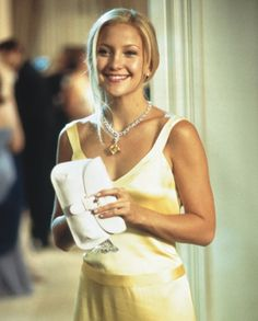 """Kate Hudson, 2003 Movie: How to Lose a Guy in 10 Days. A highlight is the scene for the """"Isadora Diamond"""" Harry Winston necklace worn on the iconicyellow gown.  Designer Karen Patch reportedly designed the satin dress after spotting the yellow sapphire."""