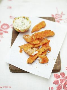 Make your own baked sole goujons with this easy recipe from Jamie Oliver, it's sure to be a hit with the family, serve with aïoli or ketchup to taste.