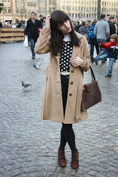1. Tan Coat  2. Black And White Shirt  3. Black Pants  4. Brown Shoes And Purse