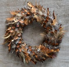 Handmade male pheasant feather wreath bound in suede with brass fixtures Feather Wreath, Feather Crafts, Feather Art, Bird Feathers, Xmas Wreaths, Autumn Wreaths, Phesant Feathers, Antler Crafts, Christmas Crafts