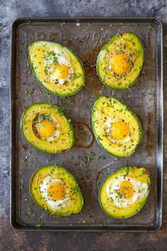 Baking eggs right in avocado halves for a healthy breakfast option to start the day off right!