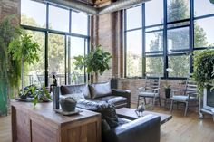 Oh, love these windows. Love the floor. I'm imagining this is all one big, open room, with a kitchen and dining area behind the camera. Hey, check out that balcony!
