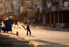 ROAD TO FREEDOM: Sri Lankan boys play a game of cricket on a deserted street in Colombo, Sri Lanka. (Eranga Jayawardena/AP)