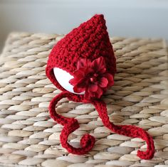 Cranberry Red Baby Bonnet with Detachable Red Flower - Crochet Knit Hat for Baby Boy or Girl - Christmas - Newborn - Made to Order. $22.00, via Etsy.