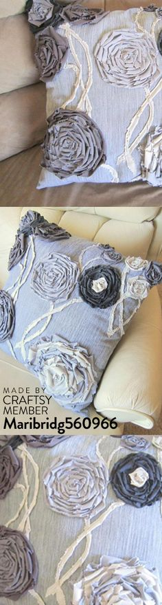 Great mix of colors in this handmade shabby flower pillow.