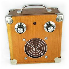 C. B. Gitty Cigar Box Standard Amplifier #4: Vintage-Style Solid Wood Acid Box. The heart is an Artec SDA-T 2.5W amp board, which is powered by a 9V battery. The amp accepts a standard 1/4 mono guitar/amp cord as input, and output is through a 3.5 1W speaker.