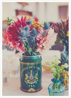 Vintage tea can floral centerpieces