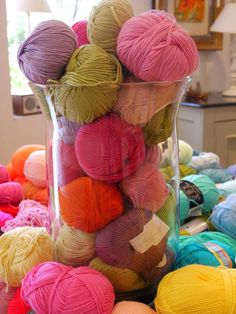 colorful yarns make a nice display in glass containers