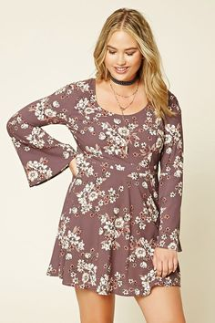 Forever 21+ - A woven mini dress featuring a floral print, scoop neck, crisscross back, long bell sleeves, and a concealed side zipper.