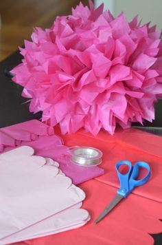 DIY tissue paper pom poms. Use orange to make pumpkins