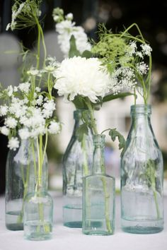 maybe bottles/vases like these for smaller flowers on sign-in table, dessert table, etc.