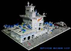 https://flic.kr/p/23E2c3d | Space Base H17 | Built for BrickWorld 2017.  Features landing pads for 10 ships.  Features over 100 lights, working turbolift, exhaust fans and iridescent planet lighting.