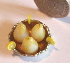 Poached Pears, decorated with slices of candied lemon, set in a silver bowl.  Ideal for any Georgian Dessert for either lunch or dinner.