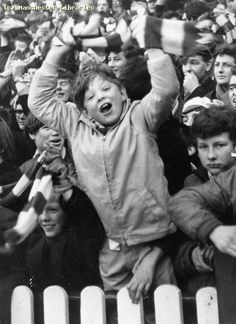 Child in a crowd at a Football Match at Old Trafford, 1970 by mcrarchives, via Flickr
