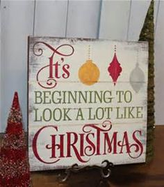 this is a floor standing christmas plaques with a retro rustic vintage look to it which makes it look old fashioned.