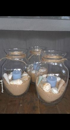 Made my own centerpieces for my beach themed Quinceanera ! Found the shells, candles, and vases all at the dollar tree ! Made my own centerpieces for my beach themed Quinceanera ! Found the shells, candles, and vases all at the dollar tree ! Beach Themed Crafts, Beach Crafts, Shell Candles, Diy Candles, Quinceanera, Beach Centerpieces, Beach Centerpiece Wedding, Dollar Tree Centerpieces, Beach Bathrooms
