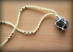 Check out this item in my Etsy shop https://www.etsy.com/listing/470824523/beach-stone-macrame-necklace-boho-style