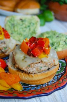 Sweet and Spicy Turkey Burgers with Guacamole are perfect for tailgating season. Sweet peppers, spicy cheese make these delicious.
