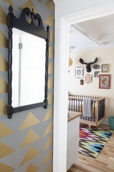 What a fun modern triangle accent wall leading in to the nursery!