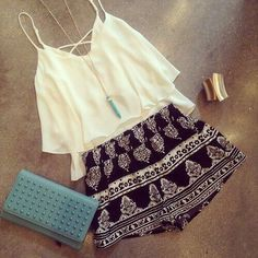 Loose crop top, black Aztec shorts and a blue studded clutch... Beautiful outfit!