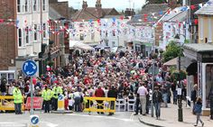Taking over the streets: Police close the road through Cuckfield, West Sussex, as hundreds of residents congregate for the festivities in far drier conditions than Sunday West Sussex, English Village, Queens, Police, Take That, Sunday, England, Street View, Europe, Spaces