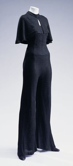 """Beachwear, Jean Patou: ca. 1929, rayon knit jump-suit with matching cape. """"...This is a piece of Jean Patou's, who worked with sportswear from his early period. The 'garçonne', a new style for women popular after World War I, aimed to eliminate the gender bias in clothing. Women started wearing pants, which had formerly been a symbol of men's attire, although they were only worn inside the house or at resorts..."""""""