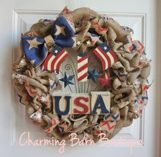 This beautiful patriotic wreath would be a great addition to your door to celebrate the 4th of July. This wreath measures 23 x 23 x 5. It is