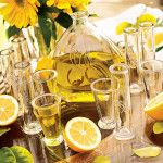 Limoncello with lemons and limes in vodka or rum