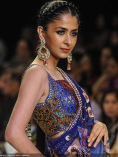 A model walks the ramp jewellery brand Prisha during the India International Jewellery Week (IIJW), held at Grand Hyatt, Mumbai, on August 07, 2013.
