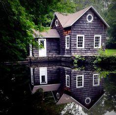 shingled lakeside cottage